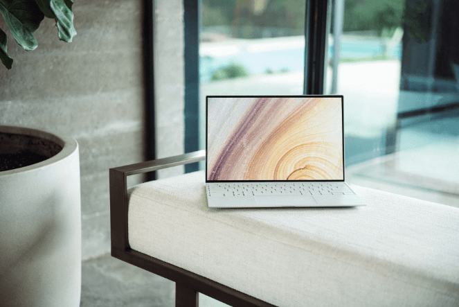 A stock photo of a laptop on a chair