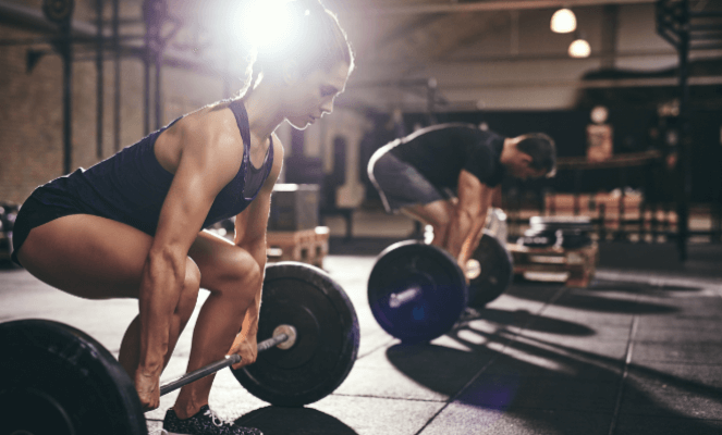 Two people working out. This is an example of a useful stock image